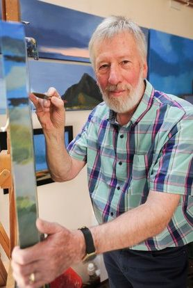 Photograph of Stuart Green at work at his easel.
